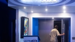 A moviegoer steps into an auditorium at a Cineplex Movie Theatre in Toronto on Friday, July 16, 2021, as movie theatres reopen during the latest easing of COVID-19 restrictions. THE CANADIAN PRESS/Chris Young