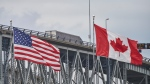 A truck crosses the Bluewater Bridge border crossing between Sarnia, Ont., and Port Huron, Michigan on Sunday August 16, 2020. THE CANADIAN PRESS/Geoff Robins