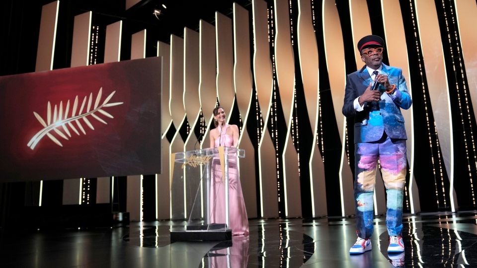 Jury president Spike Lee, right, appears during the awards ceremony for the 74th international film festival, Cannes, southern France, Saturday, July 17, 2021. (AP Photo/Vadim Ghirda)