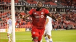 Toronto FC forward Jozy Altidore (17) celebrates after scoring during second half MLS soccer action against Orlando City, in Toronto, Saturday, July 17, 2021. THE CANADIAN PRESS/Chris Katsarov
