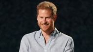 """Prince Harry, Duke of Sussex, speaks at """"Vax Live: The Concert to Reunite the World"""" on May 2, 2021, in Inglewood, Calif. Harry is writing what his publisher is calling an """"intimate and heartfelt memoir."""" Random House announced on Monday, July 19, 2021, that the book, currently untitled, is expected to come out late in 2022. (Photo by Jordan Strauss/Invision/AP, File)"""