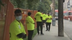 Security is seen outside a fenced area of Alexandra Park as the city works to clear an encampment on Tuesday morning.