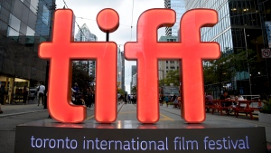 """FILE - In this Thursday, Sept. 6, 2018, file photo, a view of a festival sign appears on Day 1 of the Toronto International Film Festival in Toronto. Organizers announced Tuesday, July 20, 2021, that among the films that premiere at this year's TIFF will be the adaptation of the Tony-winner """"Dear Evan Hansen,"""" which will open the festival, Edgar Wright's '60s London themed """"Last Night in Soho,"""" and """"The Eyes of Tammy Faye."""" TIFF runs Sept. 9-18. (Photo by Chris Pizzello/Invision/AP, File)"""