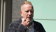 Former Sex Pistols front man John Lydon, also known as Johnny Rotten, arrives for a legal hearing with two former Sex Pistols band members over the use of their songs in an upcoming television series Monday July 19, 2021. The TV series, Pistol, is based on a 2016 memoir by guitarist Steve Jones, and with drummer Paul Cook they are bringing legal action against Lydon, so that songs from the punk band's back catalogue can be used in the show. (Yui Mok/PA via AP)