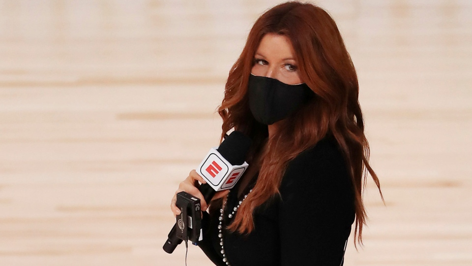 In this Friday, July 31, 2020, file photo, ESPN reporter Rachel Nichols stands on the court before an NBA basketball game between the Houston Rockets and the Dallas Mavericks, in Lake Buena Vista, Fla. (Mike Ehrmann/Pool Photo via AP, File)