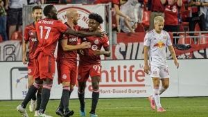 Toronto FC celebrate after midfielder Ralph Priso (97) scores during second half MLS soccer action against the New York Red Bulls in Toronto, on Wednesday, July 21, 2021. THE CANADIAN PRESS/Chris Katsarov