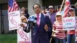 FILE - In this July 13, 2021, file photo radio talk show host Larry Elder speaks to supporters during a campaign stop in Norwalk, Calif. Superior Court Judge Laurie M. Earl ruled Wednesday July 21, that Elder's name should be placed on the ballot for the Sept. 14 recall election aimed at removing Democratic Gov. Gavin Newsom. Judge Earl disagreed with a state decision that Elder failed to meet requirements to qualify to run in the election. (AP Photo/Marcio Jose Sanchez, File)