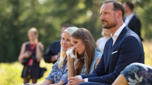Crown Princess Mette-Marit, Princess Ingrid Alexandra and Crown Prince Haakon during the memorial service on Utoya island, Norway, Thursday July 22, 2021. Commemorations to mark 10-years since Norway's worst ever peacetime slaughter when right wing extremist Anders Breivik set off a bomb in the capital, Oslo, killing eight people, before heading to tiny Utoya island where he stalked and shot dead 69 mostly teen members of the Labor Party's youth wing. (Beate Oma Dahle / NTB via AP)