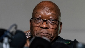 In this Sunday, July 4, 2021 file photo, former President Jacob Zuma addresses the press at his home in Nkandla, KwaZulu-Natal Province, South Africa. Former South African president Jacob Zuma is being allowed to leave prison to attend his brother's funeral. A statement by the correctional services department says Zuma will be permitted to wear civilian clothes at the funeral on Thursday, July 22, 2021. (AP Photo/Shiraaz Mohamed, File)