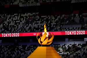 The Olympic flame burns from the cauldron during the opening ceremony in the Olympic Stadium at the 2020 Summer Olympics, Friday, July 23, 2021, in Tokyo, Japan. (AP Photo/Ashley Landis)