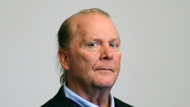 FILE - In this May 24, 2019, file photo, celebrity chef Mario Batali is arraigned on a charge of indecent assault and battery in Boston Municipal Court in Boston, in connection with a 2017 incident at a Boston restaurant. New York's attorney general Letitia James announced a $600,000 settlement with Batali and his former business partner Joseph Bastianich after investigators alleged a hostile work environment at their restaurants. (David L Ryan/The Boston Globe via AP, Pool, File)