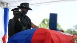 Former first lady of Haiti, Martine Moise, stands over the casket of her slain husband, former President Jovenel Moise, during his funeral at his family home in Cap-Haitien, Haiti, Friday, July 23, 2021. Martine Moise was injured in the July 7 attack at their private home, and returned to the Caribbean nation following her release from a Miami hospital. (AP Photo/Matias Delacroix)