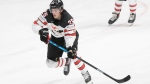 Canada's Owen Power controls the puck during the Ice Hockey World Championship semifinal match between the United States and Canada at the Arena in Riga, Latvia, Saturday, June 5, 2021. (AP Photo/Sergei Grits)