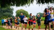 People take part in the Park Run at Bushy Park in London, Saturday July 24, 2021, one of many runs taking place across the country for the first time since March 2020 when the event was closed due to the COVID-19 pandemic. (Victoria Jones/PA via AP)