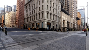 A normally busy shopping area in Sydney is nearly empty of people, Wednesday, July 7, 2021. Sydney's two-week lockdown has been extended for another week due to the vulnerability of an Australia population largely unvaccinated against COVID-19, officials said. (AP Photo/Rick Rycroft)