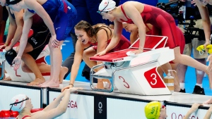 Canada's Rebecca Smith, Kayla Sanchez, Margaret MacNeil and Penny Oleksiak celebrate a silver medal in the women's 4 x 100m freestyle relay during the Tokyo Olympics in Tokyo, Japan on Sunday, July 25, 2021. THE CANADIAN PRESS/Frank Gunn