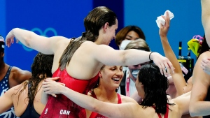 Canada's Penny Oleksiak, Rebecca Smith, Kayla Sanchez and Margaret MacNeil celebrate a silver medal in the women's 4 x 100m freestyle relay during the Tokyo Olympics in Tokyo, Japan on Sunday, July 25, 2021. THE CANADIAN PRESS/Frank Gunn