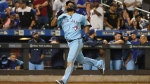 Toronto Blue Jays' Teoscar Hernandez gestures as he runs the bases after hitting a two-run home run during the ninth inning of a baseball game against the New York Mets, Saturday, July 24, 2021, in New York. (AP Photo/Mary Altaffer)