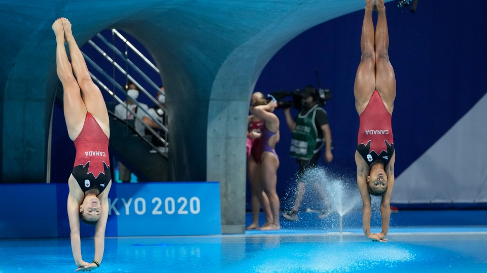 Jennifer Abel and Melissa Citrini Beaulieu of Canada compete during the Women's Synchronized 3m Springboard Final at the Tokyo Aquatics Centre at the 2020 Summer Olympics, Sunday, July 25, 2021, in Tokyo, Japan. (AP Photo/Dmitri Lovetsky)