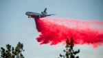 FILE - In this July 2, 2021, file photo a DC-10 air tanker drops retardant while battling the Salt Fire near the Lakehead community of Unincorporated Shasta County, Calif. Airport officials facing jet fuel shortages are concerned they'll have to wave off fire retardant bombers and helicopters when wildfire season heats up, potentially endangering surrounding communities. (AP Photo/Noah Berger, File)