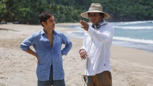 """This image released by Universal Pictures shows Gael García Bernal, left, and filmmaker M. Night Shyamalan on the set of """"Old."""" (Universal Pictures via AP)"""