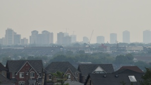 A hazy sky is seen in Toronto on Sunday, July 25, 2021. Environment Canada has issued a special air quality statement for the city due to forest fire smoke. (CP24/Bryann Aguilar)