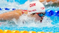Margaret Mac Neil of Canada competes in the women's 100m butterfly semifinal during the Tokyo Olympics in Tokyo, Japan on Sunday, July 25, 2021. THE CANADIAN PRESS/Frank Gunn