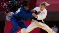 Canada,s Jessica Klimkait competes against France,s Sarah Cysique during the semi-final in women's 57kg Judo competition at the Tokyo Olympics, Monday, July 26, 2021 in Tokyo, Japan. THE CANADIAN PRESS/Adrian Wyld