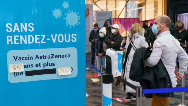 People line up at walk-in COVID-19 vaccination clinic to receive the AstraZeneca vaccine in Montreal, on Wednesday, April 21, 2021. Quebecers 45 and over can now get the AstraZeneca vaccine across the province.THE CANADIAN PRESS/Paul Chiasson