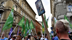 People march during a protest against the government's alleged use of powerful spyware to spy on opponents, Budapest, Hungary, July 26, 2021. A report released more than a week ago by investigative journalists suggested the government used the software to monitor critical journalists, politicians and businesspeople through their smartphones. (AP Photo/Anna Szilagyi)