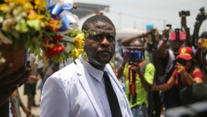 """Jimmy Cherizier, alias Barbecue, a former police officer who heads a gang coalition known as """"G9 Family and Allies, leads a march to demand justice for slain Haitian President Jovenel in Lower Delmas, a district of Port-au- Prince, Haiti Monday, July 26, 2021. Moise was assassinated on July 7 at his home. (AP Photo/Joseph Odelyn)"""