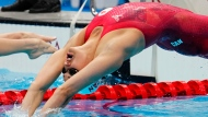 Canada's Kylie Masse competes in the women's 100m backstroke semifinal during the Tokyo Olympics in Tokyo, Japan on Monday, July 26, 2021. THE CANADIAN PRESS/Frank Gunn