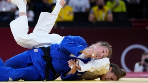 Anriquelis Barrios of Venezuela, right and Catherine Beauchemin-Pinard of Canada compete in a women -63kg bronze medal match of the judo match at the 2020 Summer Olympics in Tokyo, Japan, Tuesday, July 27, 2021. (AP Photo/Vincent Thian)