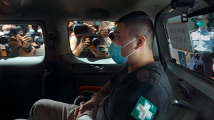FILE - In this July 6, 2020, file photo, Tong Ying-kit arrives at a court in a police van in Hong Kong. Tong, the first person to be tried under Hong Kong's sweeping national security law was found guilty of secessionism and terrorism on Tuesday, July 27, 2021. (AP Photo/Vincent Yu, File)