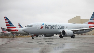 """FILE - An American Airlines Boeing 737 Max taxis at Tulsa International Airport to fly to Dallas, Wednesday, Dec. 2, 2020, in Tulsa, Okla. American Airlines says it's running into fuel shortages at some smaller and mid-size airports, and in some cases the airline will add refueling stops or fly fuel into locations where the supply is tight. American said fuel supplies are being squeezed at """"several"""" airports, which it didn't name, mostly because of a shortage of tanker trucks or drivers. (Mike Simons/Tulsa World via AP, File)"""