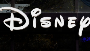 FILE- In this Sept. 20, 2017, file photo, the logo of a Disney store is pictured on the Champs Elysees Avenue in Paris, France. The Walt Disney Co. reports earnings Tuesday, Aug. 7, 2018. (AP Photo/Francois Mori, File)