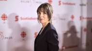 """FILE- Rachel Cusk, nominated for her book """"Transit"""" arrives at the Giller Prize Awards ceremony in Toronto on Monday, November 20, 2017. THE CANADIAN PRESS/Chris Young"""