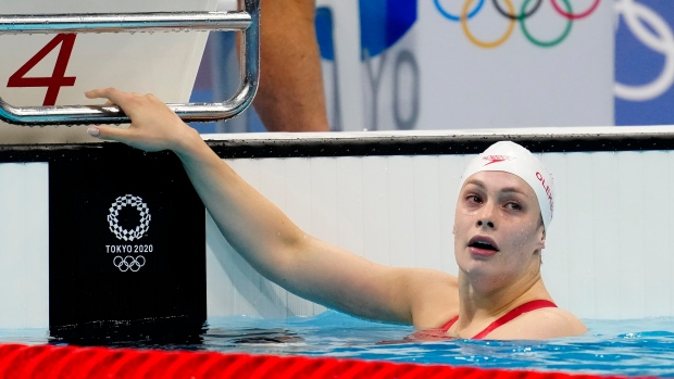 Canada's Penny Oleksiak looks up at her time after placing 4th in the women's 200m freestyle semifinal event during the Tokyo Summer Olympic Games, in Tokyo, Tuesday, July 27, 2021. THE CANADIAN PRESS/Frank Gunn