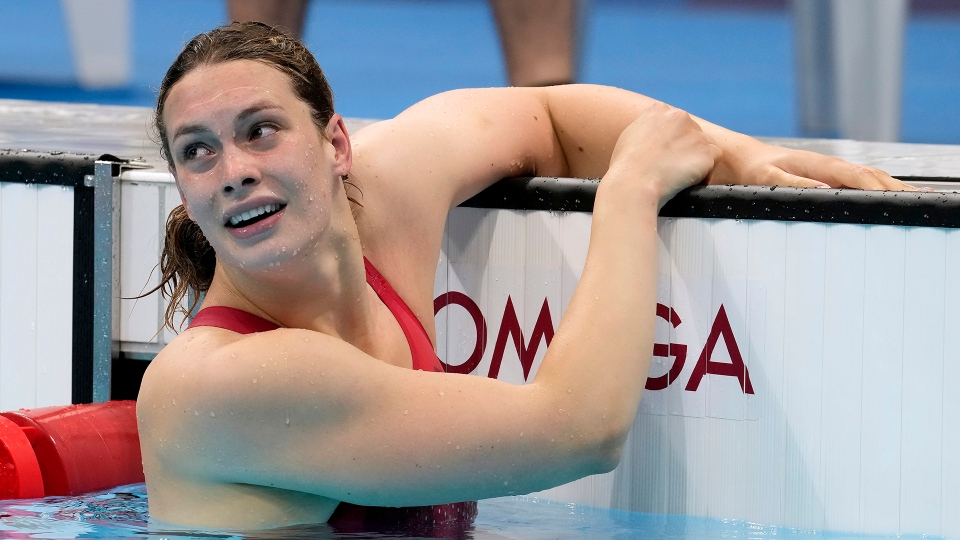 Canada's Penny Oleksiak looks up at her results after swimming to take the bronze medal in the women's 200m freestyle final event during the Tokyo Summer Olympic Games, in Tokyo, Wednesday, July 28, 2021. THE CANADIAN PRESS/Frank Gunn