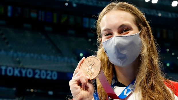 Canada's Penny Oleksiak shows off her bronze medal won in the women's 200m freestyle final event during the Tokyo Summer Olympic Games, in Tokyo, Wednesday, July 28, 2021. THE CANADIAN PRESS/Frank Gunn