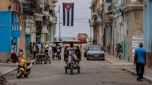 A man rides a pedicab through the streets of Havana, Cuba, Monday, July 26, 2021 (AP Photo/Eliana Aponte)