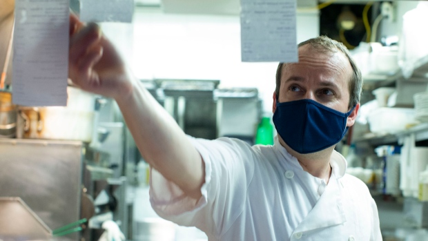 Chef Dimitris prepares a take-out order at Athens Restaurant in Toronto, on Saturday, June 5, 2021. THE CANADIAN PRESS/Chris Young
