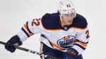 FILE - Edmonton Oilers player Tyson Barrie plays during an NHL hockey game against the Calgary Flames in Calgary, Alberta, in this Friday, Feb. 19, 2021, file photo. Edmonton has re-signed defenseman Tyson Barrie before he was eligible to become a free agent. (AP Photo/Larry MacDougal)