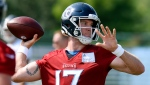 Tennessee Titans quarterback Ryan Tannehill (17) throws a pass during NFL football training camp Wednesday, July 28, 2021, in Nashville, Tenn. (AP Photo/Mark Zaleski)