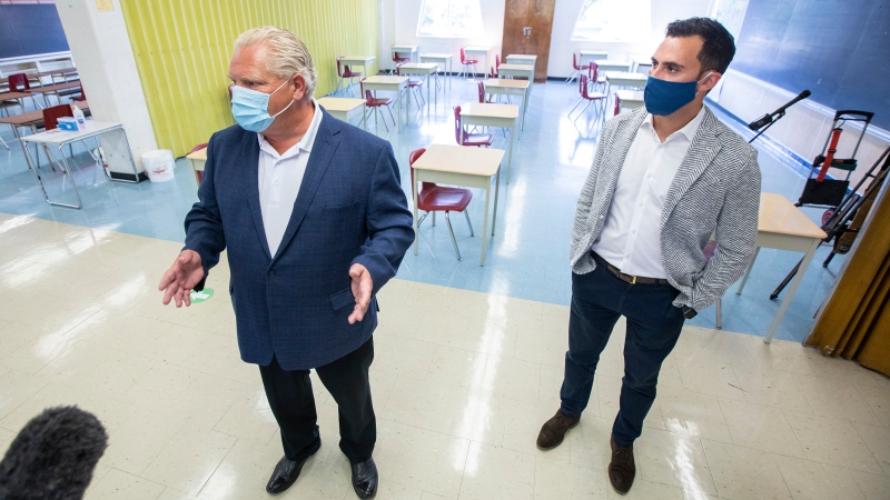 Ontario Premier Doug Ford, left, and Education Minister Stephen Lecce take a tour of Kensington Community School to see the measures implemented as students return to school amidst the COVID-19 pandemic on Tuesday, September 1, 2020. THE CANADIAN PRESS/Carlos Osorio