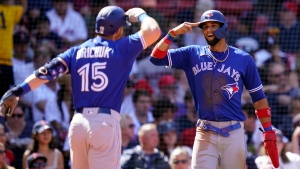Toronto Blue Jays' Randal Grichuk (15) celebrates with Lourdes Gurriel Jr., right, after hitting a two-run home run in the fourth inning of a baseball game at Fenway Park, Wednesday, July 28, 2021, in Boston. (AP Photo/Charles Krupa)