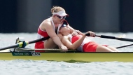 Canada's Caileigh Filmer and Hillary Janssens react after their bronze medal win in the women's pair rowing final event during the Tokyo Summer Olympic Games, in Tokyo, Thursday, July 29, 2021. THE CANADIAN PRESS/Nathan Denette