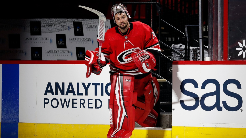Carolina Hurricanes goaltender Petr Mrazek (34) salutes the fans following the game against the Florida Panthers at an NHL hockey game in Raleigh, N.C., Tuesday, April 6, 2021. (AP Photo/Karl B DeBlaker)