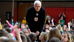 """FILE - In this Wednesday, March 4, 2020, file photo, children's book author and illustrator Marc Brown, an Erie, Pa., native, meets with Grandview Elementary School students in Millcreek Township, Pa. Brown is a three-time Emmy award winner and the creator of the """"Arthur"""" television series adapted from his books. """"Arthur"""" will soon come to an end. Kathy Waugh, an original developer of the show, said during a podcast released Wednesday, July 28, 2021, that PBS Kids plans to end the long-running children's series after 25 seasons. The final season will air in 2022. (Jack Hanrahan/Erie Times-News via AP, File)"""