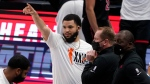 Toronto Raptors' Fred VanVleet, center, gestures down court as he stands by head coach Nick Nurse, second from right, late in the second half of an NBA basketball game against the Dallas Mavericks in Dallas, Friday, May 14, 2021. VanVleet did not play in their 114-110 loss to the Mavericks. (AP Photo/Tony Gutierrez)